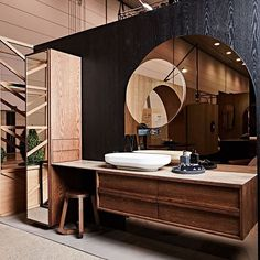 Our #issybyzuster #butterflyvanity exclusive to @reecebathrooms on display @denfair #coriantop basin designed by @thomas.coward #bathroomstorage tiles by @urbanedgeceramics pic by @mikebakerphotographer #hazelnut finish on #americanoak