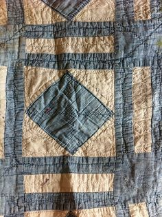 antique denim quilt ... hidden inside a newer quilt. Read about it at http://www.goodtwinbadtwin.com/2011/06/glad-rags-and-hobo-dreams.html