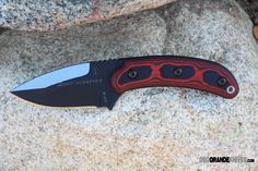"""TOPS SGTS-01 Sgt Scorpion Knife. Tops Sgt. Scorpion. 8"""" overall. 3 3/8"""" black traction coated 1095 carbon steel blade. Red and black micarta handles. Black Kydex sheath. Country of Origin: USA. http://www.osograndeknives.com/catalog/fixed-blade-edc-knives/tops-sgts-01-sgt-scorpion-knife-6873.html"""