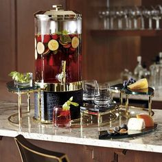 Inspired by renowned chef Michael Mina, our eye-catching tiered stands fit around the beverage tub to provide extra space for drinks, garnishes, bottle openers and more. Crafted from stainless steel and glass Risers fit around beverage tub Can also be used as stand-alone servers