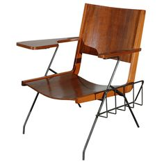 For Sale on - Pierre Guariche iron feet and walnut seat chair with attached magazine rack Shelf Furniture, Cool Furniture, Luxury Furniture, Mid Century Modern Design, Mid Century Modern Furniture, Furniture Styles, Furniture Design, Pierre Guariche, Metal Storage Cabinets