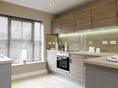 The #kitchen has a breakfast bar and French patio doors that lead to the garden from the dining and snug area. #Strata