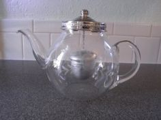 Old Pyrex teapot with tea infuser.