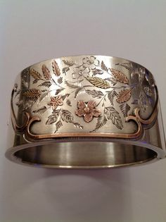 Attractive Victorian Sterling Silver Engraved & Bi Gold Decorated Hinged Bangle   $501.00