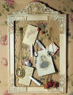 """EDWARDIAN MEMORABILIA FRAME Antiquity befriends chicken wire to accommodate everything from earrings to concert tickets. 3 clothespins included. French white finish. Wood. 20""""."""