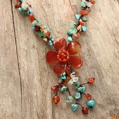 Complement any outfit with this floral Agate necklace. Featuring a variety of beautiful colors, including red, blue, and brown, this necklace is easy to match with many ensembles. At almost 16 inches long, this stunning piece is sure to draw attention.
