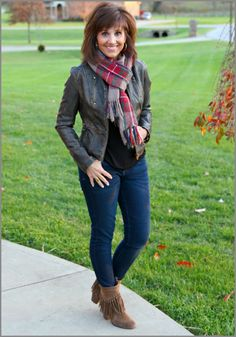 Styling a moto jacket with a plaid scarf and skinny jeans.