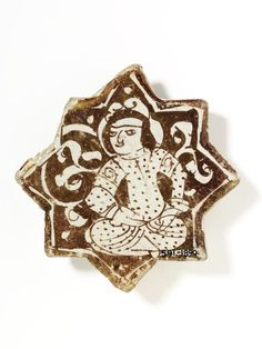 Tile      Place of origin:      Kashan, Iran (made)     Date:      early 13th century (made)     Artist/Maker:      Unknown (production)     Materials and Techniques:      Fritware painted in lustre over the glaze