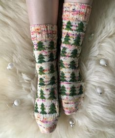 These Christmas socks are sure to get you in a festive mood! Knit from the top-down these socks featuring a forest of fir trees in a snowy field will keep your feet warm whilst out in the cold. Find this pattern at LoveKnitting.Com.