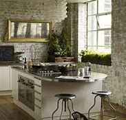 Urban loft kitchen - modern white kitchen cabinets with exposed brick walls - 25 beautiful homes mixing styles creates a sophisticated industrial Brick Wall Kitchen, Loft Kitchen, Kitchen Island, Stone Kitchen, Urban Kitchen, Kitchen Modern, Kitchen Backsplash, Modern Kitchens, Backsplash Ideas