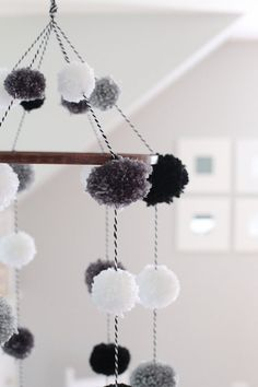 Handmade Pom Pom Mobile with Stained Wooden Hoop by Shop180