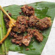 Indonesian Beef Rendang | cloves, nutmeg, chiles, shallots, nuts, garlic, tumeric, ginger, galangal, beef, Kaffir lime leaves, lemongrass, cinnamon, coconut milk