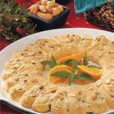 """Orange Breakfast Ring Recipe- Recipes  """"This beautiful breakfast ring is perfect for a special occasion,"""" writes Wendy Fitzgerald from her home in Eau Claire, Michigan. Whether formed into a festive wreath or shaped into two rectangles, it's so yummy that no one will ever suspect the sweet treat starts with convenient crescent rolls."""