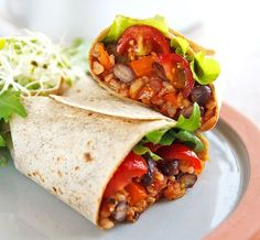 This healthy, oil-free bean burrito recipe is from Forks Over Knives. or this Vegan Bean Burrito recipe you'll need:  onions garlic peppers (bell peppers and jalapeno pepper) tomatoes (fresh or canned) brown rice black Beans (no salt added) spices: cumin, chili powders, paprika, and salt and pepper to taste Adjust the spices to suit your spice preferences.