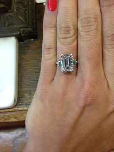 PART OF OUR COLLECTION- Art Deco emerald cut diamond ring with little emeralds on the sides