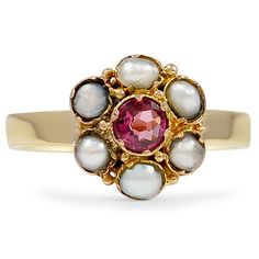 The Ania Ring from Brilliant Earth circa 1890's A stunning garnet is the center of this lovely floral-inspired ring from the Victorian era. Accented with gorgeous silvery natural pearl petals, this piece is finished with a flattering yellow gold band (Garnet approx. 0.23 total carat weight).