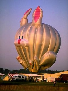 A hot air balloon shaped like a rabbit being inflated.