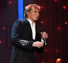 Barry Manilow performs onstage during the 2016 PreGRAMMY Gala and Salute to Industry Icons honoring Irving Azoff at The Beverly Hilton Hotel on...