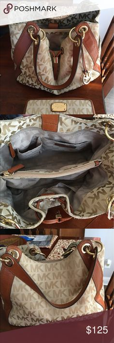 Kors tan/saddle leather purse w/matching wallet. Medium roomy handbag with lots of sections and pockets. Excellent condition. Lightly used. KORS Michael Kors Bags Shoulder Bags