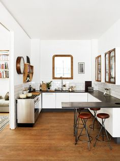 Industrial kitchen with very vintage-y accents (windows, cabinets) via B L O O D A N D C H A M P A G N E