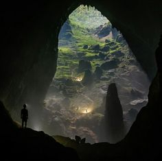Hang Son Doong Cave, Vietnam. Hang Son Doong never fails to impress. Truly an amazing place. A caver looks on towards he second doline, or sink hole. This doline has let in enough light into the cave to allow a jungle to grow. Photo by rdeboodt (Instagram)