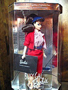 This nostalgic reproduction of the 1960 Busy Gal fashion features Barbie® doll as a brunette with the curled bangs, ponytail, and wearing the fabulous red and white fashion ensemble. The Busy Gal fashion consists of a red and white striped blouse, red jacket with matching striped lining, and a knee-length tailored red skirt. An adorable little black hat with matching red and white striped lining sits atop Barbie® doll's hair. Vintage face painting adds to the doll's nostalgic essence.