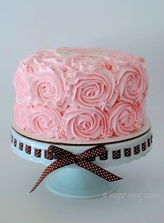 """8"""" buttercream rosette swirls.  I'm glad i did the gumpaste plaque on top... easy and elegant way to personalize."""