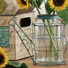 Watering Can Vase - This Metal Watering Can brings vintage charm to any room. Blossoming forth from the lightly weathered wire frame and glass insert, your favorite flowers will look simply divine.
