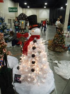 white christmas tree-like snowmn