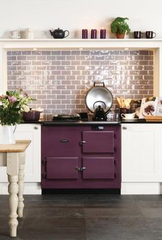 Marsh half tiles look great as a kitchen splashback. From the Cosmopolitan range at The Winchester Tile Company. Handmade ceramic tiles, made in the UK. winchestertiles.com