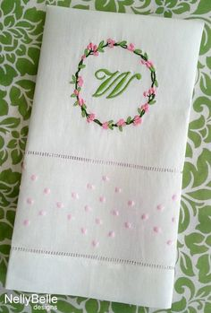 Monogrammed guest towel. Floral monogram embroidered on linen/cotton guest towel with pink french dot border. NellyBelle Designs