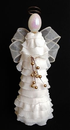 ruffled-angel - I could use this as a tree topper using the cone from the inside of one of my cotton yarn balls as a base...
