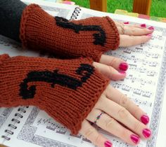 Originally made for my violin teacher, these fingerless gloves are warm, soft, and stylish! Made in a high-end merino wool yarn, they are the