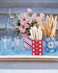 Patriotic containers, wrap any containers with red, white and blue paper and fill with goodies for your 4th of July table.