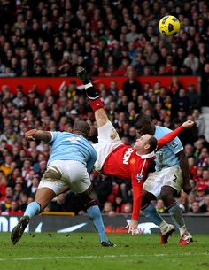 Wayne Rooney of Manchester United scores a goal from an overhead kick during the Barclays Premier League match between Manchester United and Manchester City at Old Trafford on February 2011 in. Get premium, high resolution news photos at Getty Images Real Madrid Manchester United, Manchester United Wallpaper, Manchester United Legends, Manchester United Football, Manchester City, Manchester England, David Beckham Football, Bicycle Kick, Soccer Girl Problems