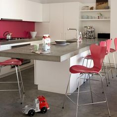 White units, grey stone, bright splashback matched with stools
