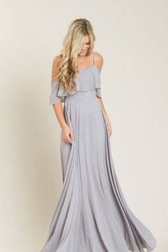 From the flowy layers of this gorgeous maxi dress, to the oversized off the shoulder ruffle detail, we can't get enough of this stunning piece! This flattering fit and flare makes this perfect for spe