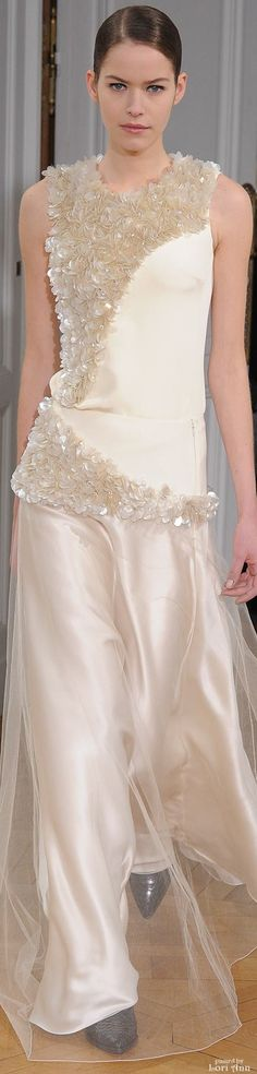 Beautiful cream color satin and embellished fabric dress. The black,hard-toed shoes, however, paired with this delicate, feminine dress, look hideous.