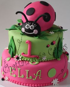 """This design was inspried by """"Fantasticakes"""" Lady Bug Cake (Thanks for your help Cécile!)  My customer wanted Lime Green and Hot Pink to match her daughters dress and party decorations.  Vanilla/Almond 10' & 8' cake tiers. The lady bug body was cut from a 7 1/2 inch oval pan and head is fondant.  TFL!!!"""