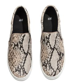 Snakeskin patterned sneakers.