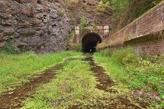 Paw Paw Tunnel II by somadjinn road path landscape location environment architecture | Create your own roleplaying game material w/ RPG Bard: www.rpgbard.com | Writing inspiration for Dungeons and Dragons DND D&D Pathfinder PFRPG Warhammer 40k Star Wars Shadowrun Call of Cthulhu Lord of the Rings LoTR + d20 fantasy science fiction scifi horror design | NotTrusty Sword art: click artwork for source