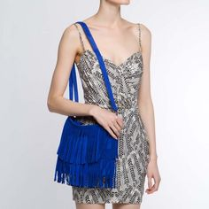 Loving this Royan electric blue fringed by The Bag Boutique.  source: http://www.shoedazzle.com/products/ROYAN?dzcode=fbf&dzcontent=product&utm_source=fbf&utm_content=product