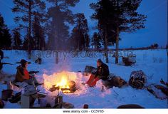 Campfire In The Snow Stock Photos & Campfire In The Snow Stock ...