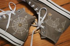 A hand painted pair of custom Converse high tops with a world map and  compass by 5c43f15c6