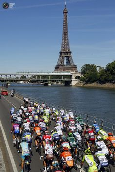 "Guess where: ""The peloton cycles past the Eiffel tower in Paris during the final 20th stage of the 99th Tour de France cycling race between Rambouillet and Paris. BOGDAN CRISTEL/REUTERS"""