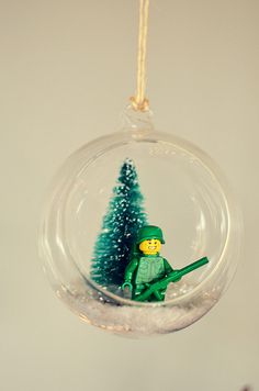 How amazing is this LEGO snow globe ornament? Lego Christmas Ornaments, Lego Christmas Village, Diy Christmas Gifts, Christmas Humor, Christmas Crafts, Christmas Ideas, Merry Christmas, Snowman Crafts, Christmas Things