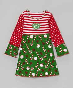 Deck the girls in this merry dress for fashion that's classic and convenient. With a festive mix of prints, darling heart appliqué and ruffles, it cuts a look that's perfect for spreading some cheer.