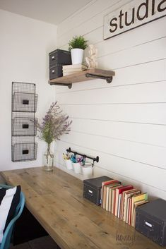 I love the shiplap wall and pencil holders to get clutter off the desk
