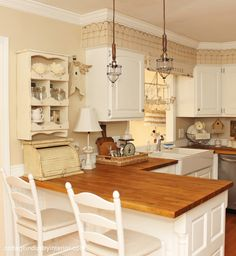A Sort Of Fairytale: Cottage Eye Candy - note short fencing along cabinets tops