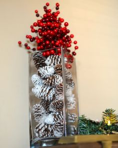 "Christmas/winter decor idea || fill a vase with ""snow-covered"" pine cones & top off with red berries"